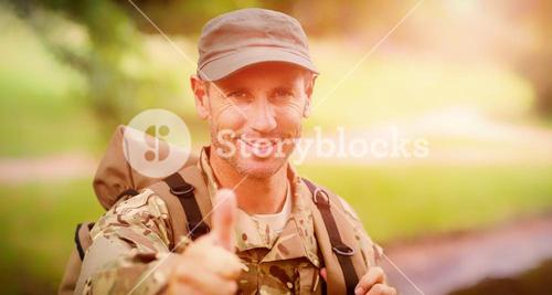 Portrait of happy army man with thumbs up
