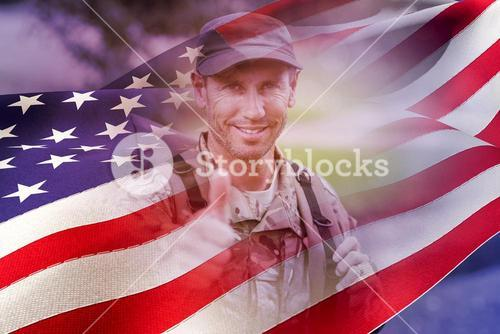 Composite image of portrait of happy army man with thumbs up