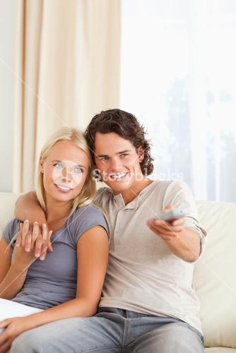 Portrait of a couple watching TV