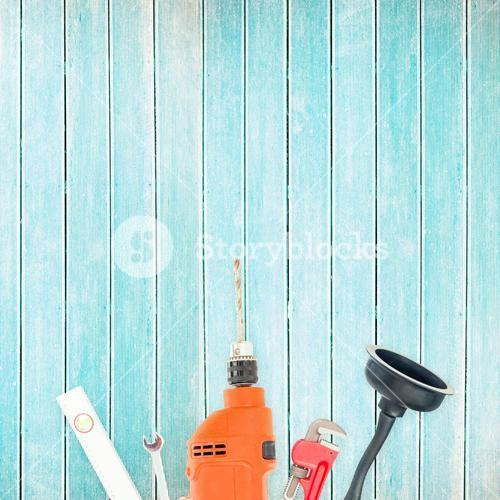 Tools on wooden background