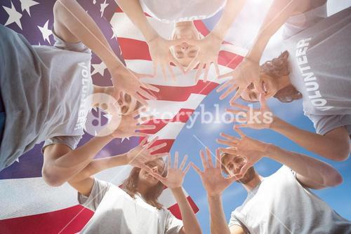 Composite image of friends putting their hands together