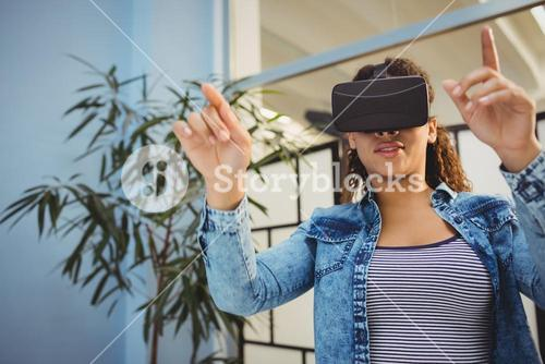 Low angle view of businesswoman enjoying augmented reality headset at office