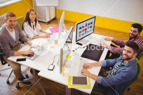 Portrait of professionals working at creative office