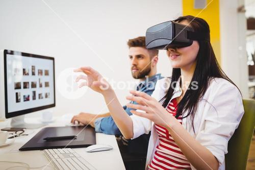 Executive enjoying augmented reality headset at creative office