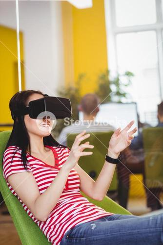 Young executive enjoying augmented reality glases at office