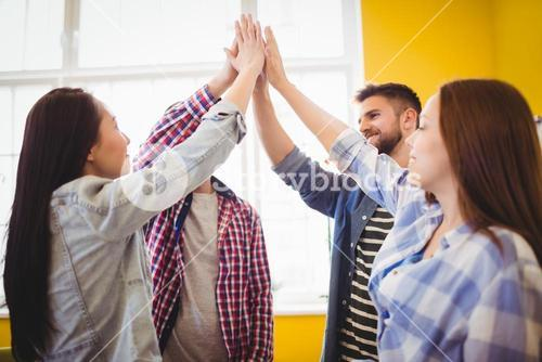 Graphic team giving high-five