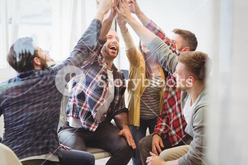 Successful creative business people giving high-five