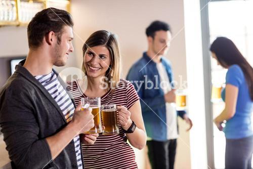 Couple with beer mug in bar