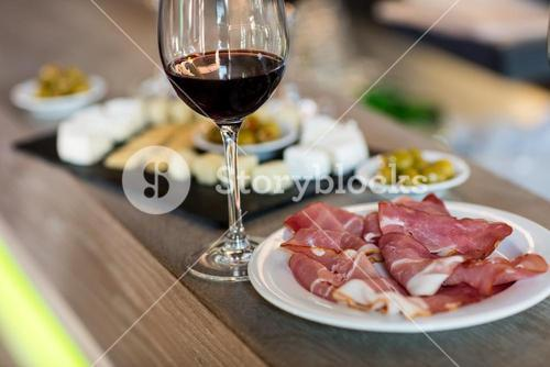Meat and wineglass on table at restaurant