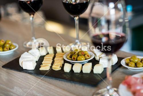 Wine and food arranged on table