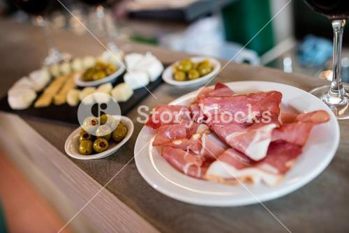 Meat and food on table in restaurant
