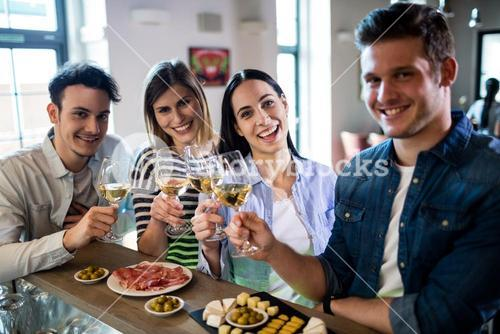 Friends enjoying wine and food at counter