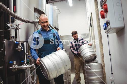 Worker and manufacturer carrying kegs