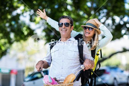 Cheerful couple riding bicycle