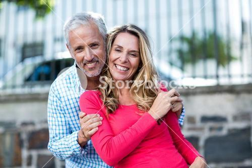 Mature couple standing on city street