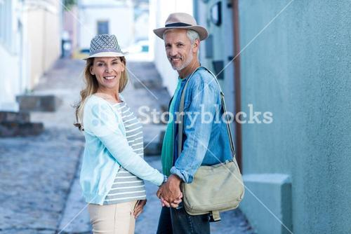 Portrait of smiling mature couple on street