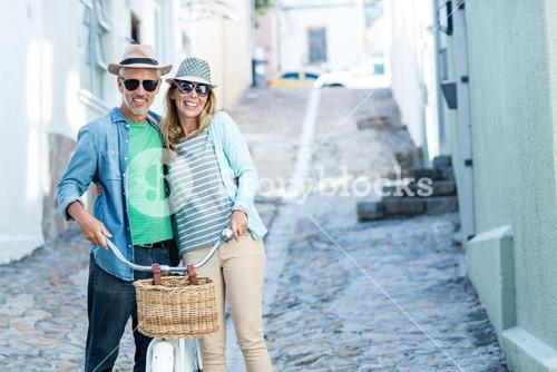 Portrait of mature couple with bicycle