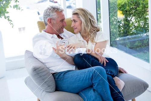 Romantic couple sitting face to face