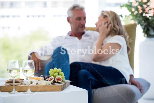 White wine and food on table with couple