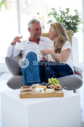 Food on table with smiling couple