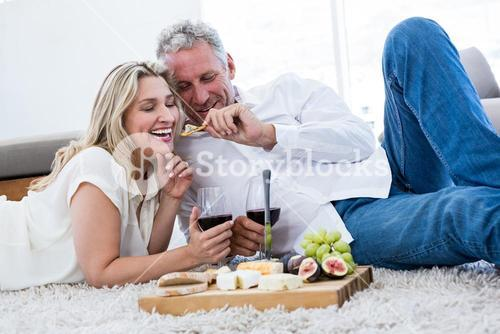 Romantic man feeding woman