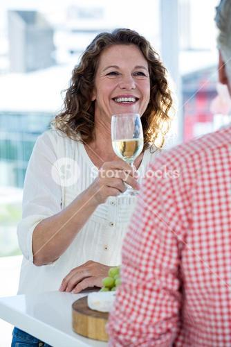 Happy woman drinking champagne