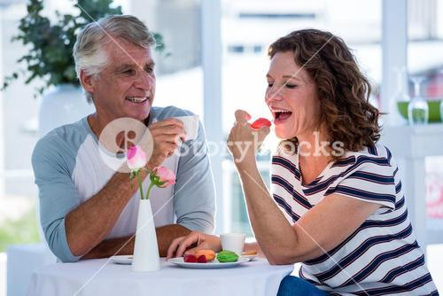 Woman with man eating food