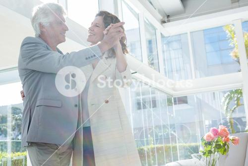 Smiling couple dancing