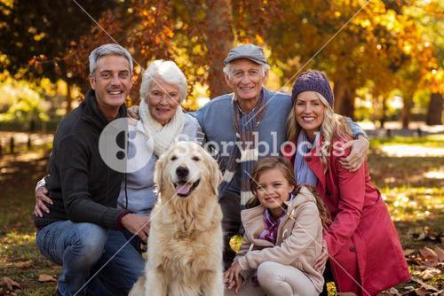Multi-generation family with dog at park