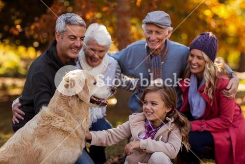 Cheerful multi-generation family at park