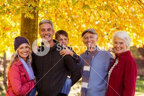 Happy multi-generation family at park