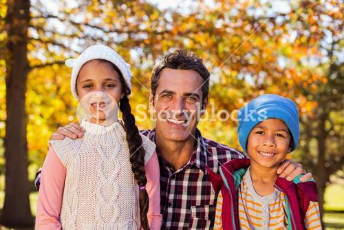 Happy father with son and daughter at park