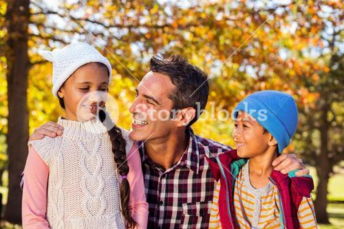 Father with son and daughter at park
