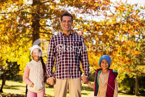 Happy father with children at park