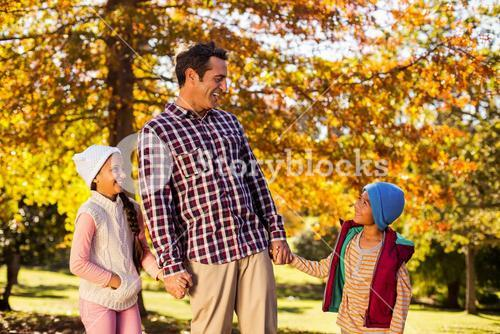 Happy father enjoying with children at park