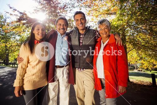 Portrait of family standing at park