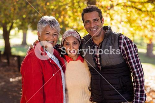 Cheerful family standing at park