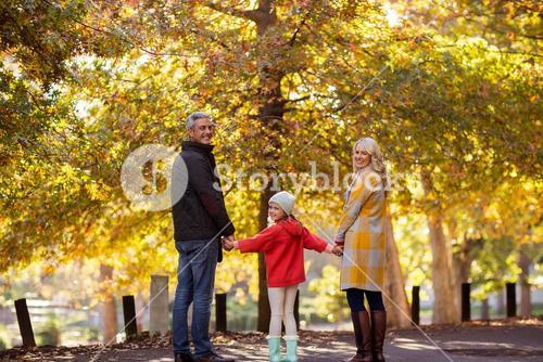 Portrait of family standing by trees