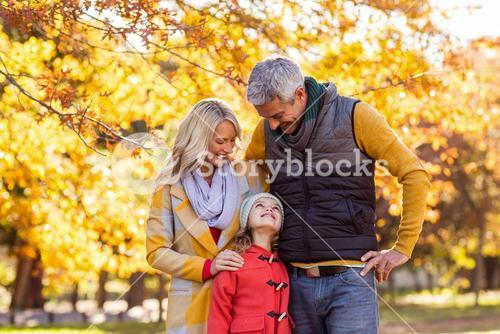 Smiling family at park during autumn