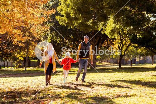 Family walking at park