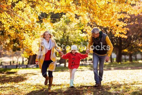 Joyful family walking at park