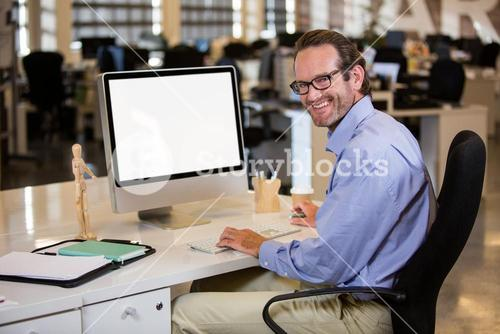 Businessman sitting at computer desk