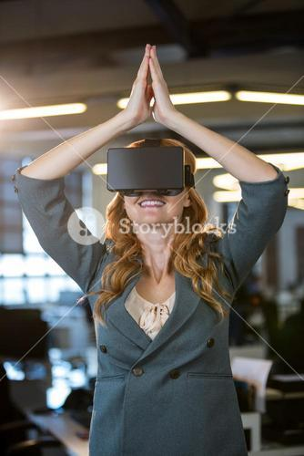 Businesswoman with hands joined using virtual reality simulator