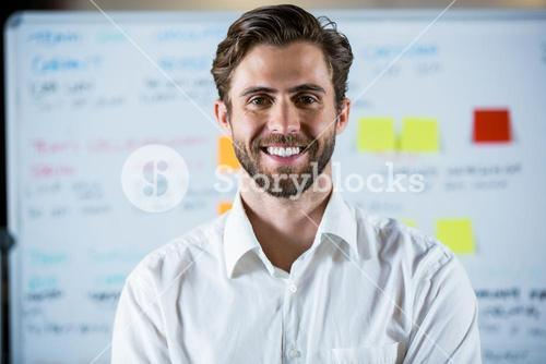 Confident businessman in meeting room
