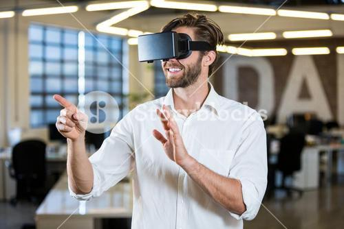 Businessman gesturing while using virtual reality simulator