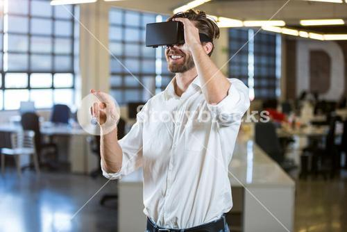 Businessman smiling while using virtual reality simulator
