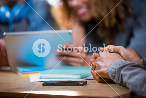 Businesswoman with hands clasped in office