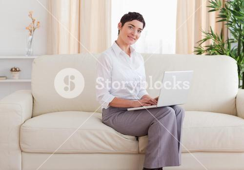 Beautiful shorthaired woman with a laptop