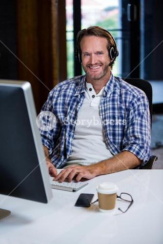 Smiling businessman working in creative office
