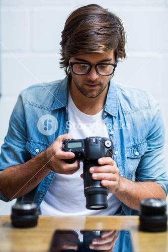 Man holding camera in office